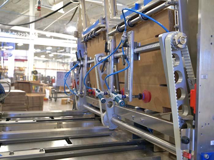 cartoning equipment laying flat blanks