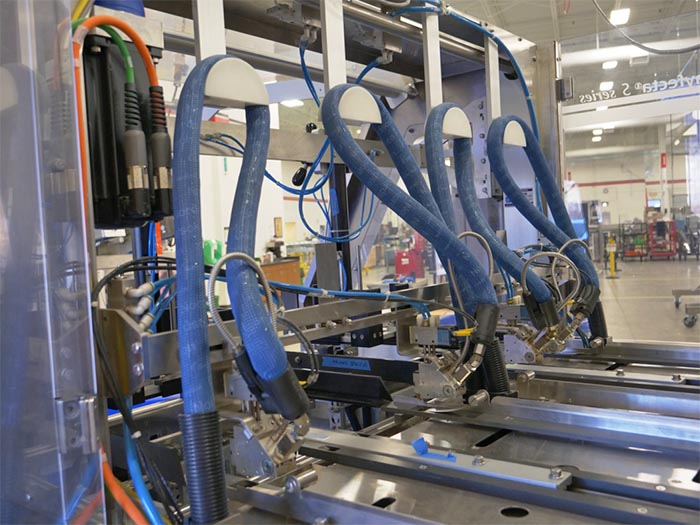 Cartoning equipment internal wiring and hosing