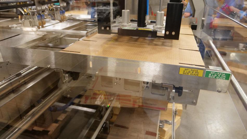 cartoning equipment erecting a large case