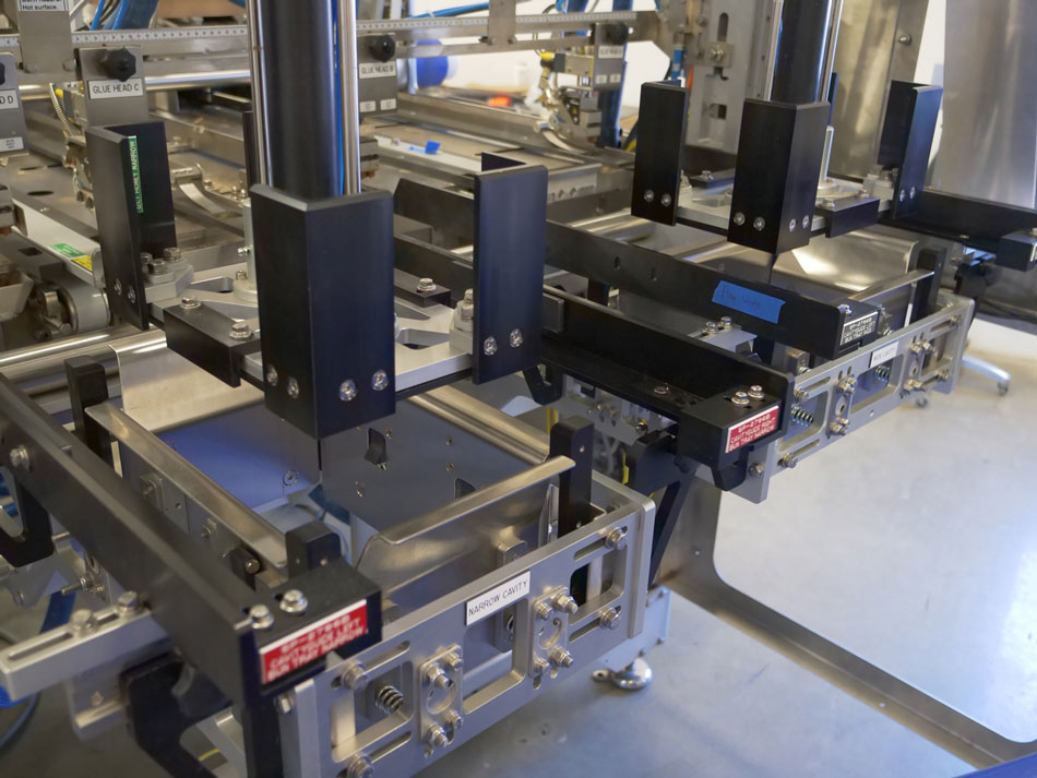 cartoning equipment changeover forming heads on tooling cart