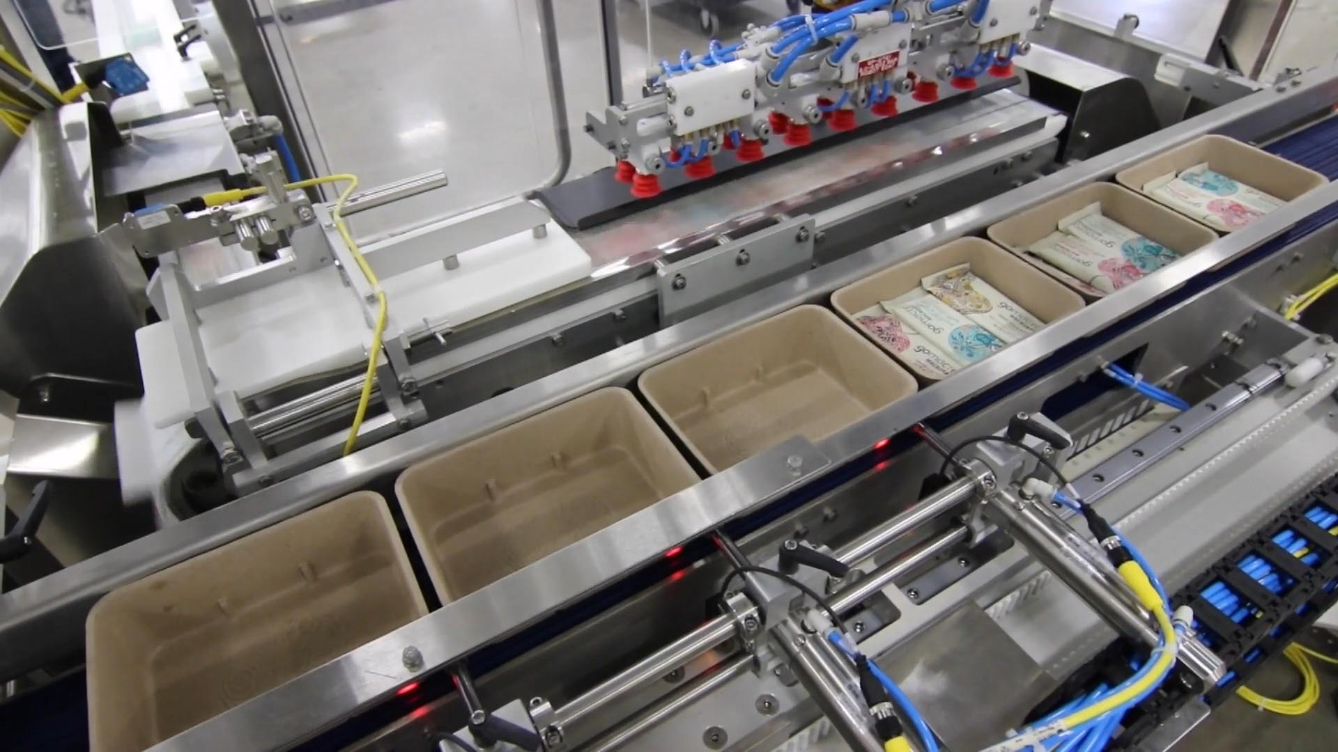 Top load cartoner servo pushers for cartons and trays