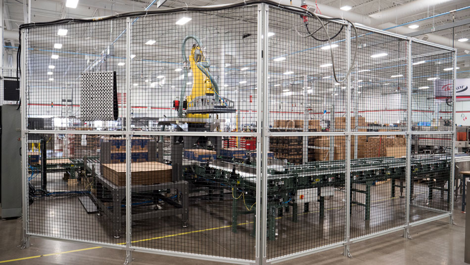 Palletizer inside of cage