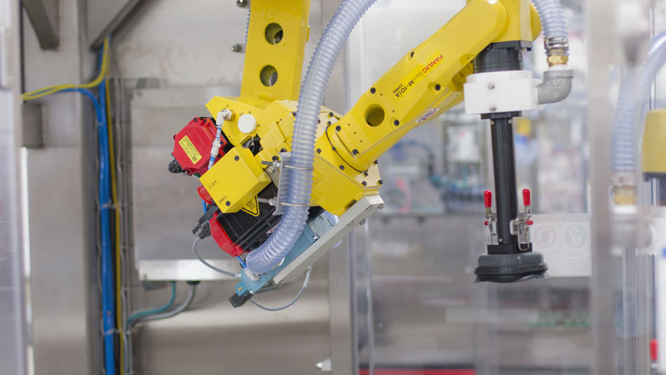 Robotic top loader with integrated FANUC robotics
