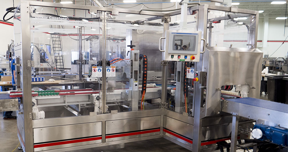 Sealing machine that can be designed left, right or inline discharge.