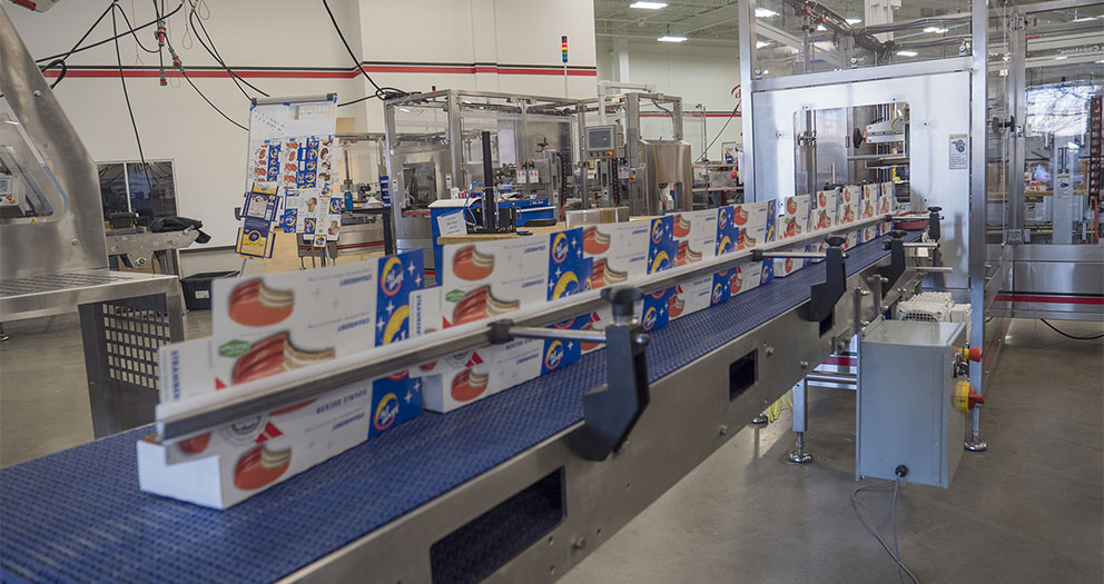 Sealing machine that can run up to 175 cartons per minute
